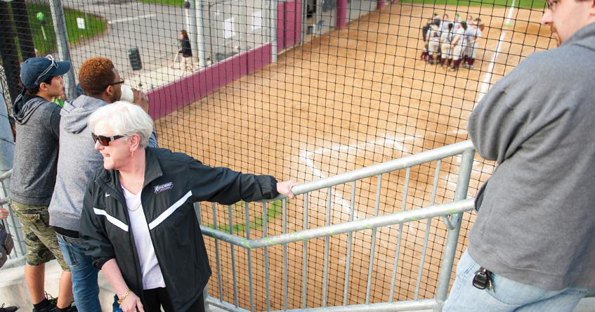 President Hirsh at a women's softball game.