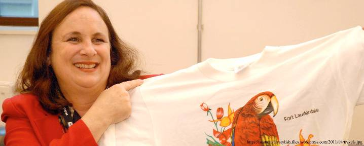 Dr. Pietra Rivoli holding a t-shirt at the Presidential Lecture