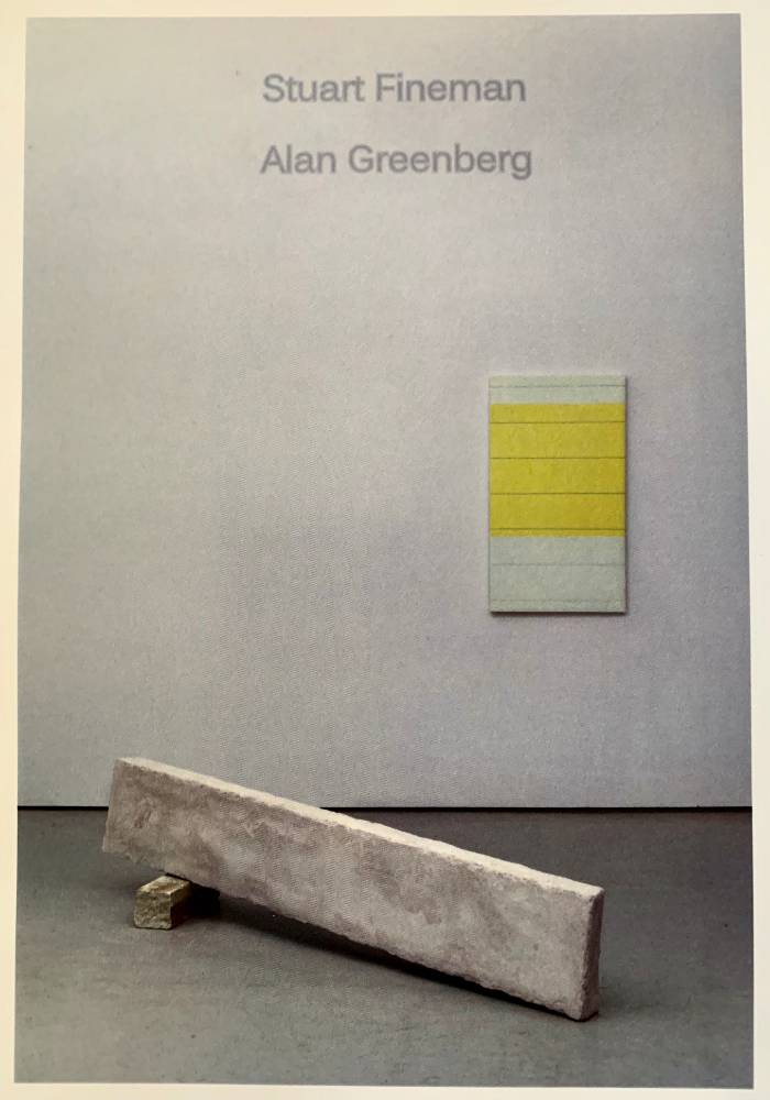An art gallery with a minimalist grey and yellow painting and a sculpture of a larger plank resting on smaller plank (like a ramp) is pictured. At the top of the image, the names Stuart Fineman and Alan Greenberg is written is a slightly darker grey font.