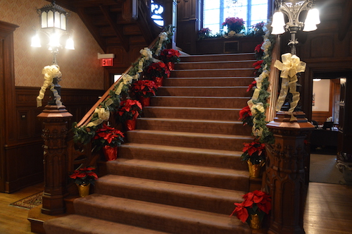 The stairs in Main Building decorated with red Christmas flowers.