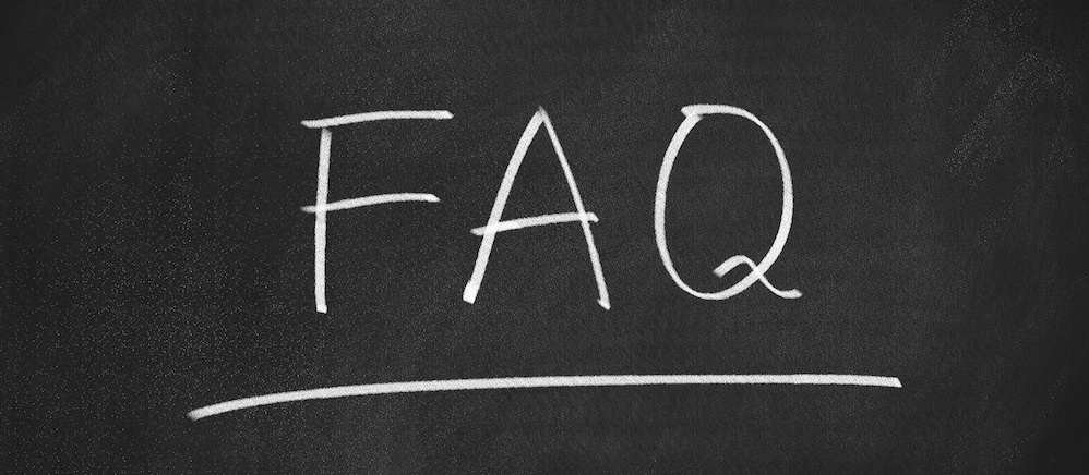 Image of FAQ written on a blackboard in chalk.