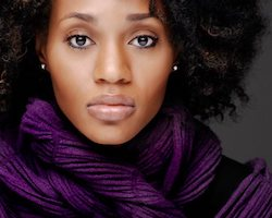 Professional of Pietra Dunmore, a young African-American woman with full, curly black hair and a purple scarf.