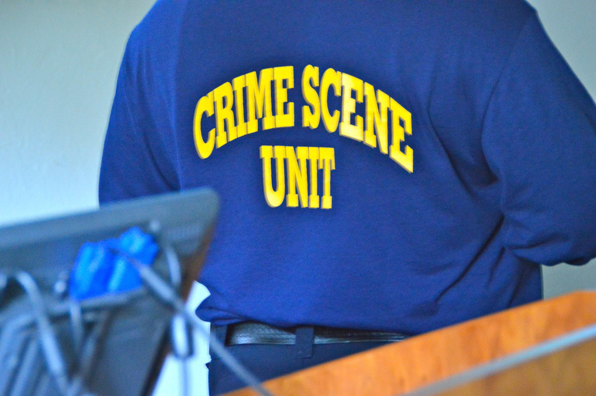 A view of someone from behind in a CSI instructor polo shirt.
