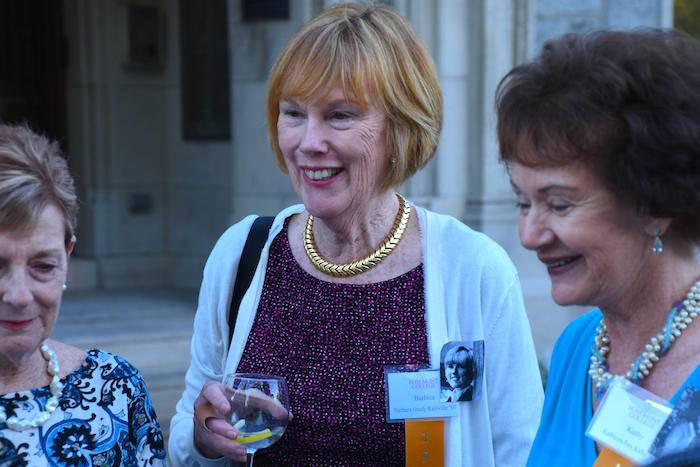 Three senior women stand together and smile at the Rosemont College reunion.