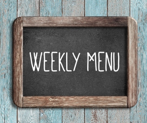 Weekly Menu Graphic of Blackboard with Chalk on it.